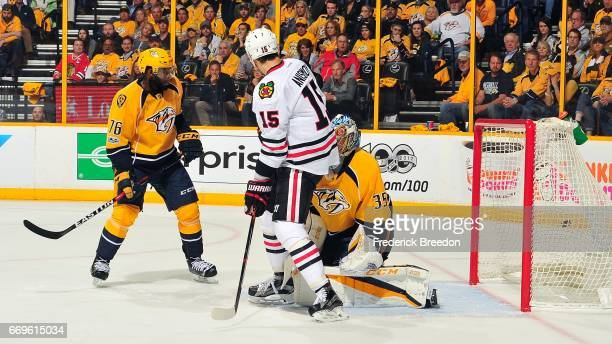 Subban of the Nashville Predators and Artem Anisimov of the Chicago Blackhawks watch a puck shot by Patrick Kane go into the net behind goalie Pekka...