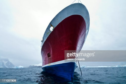 The enormous ice strengthened bow of an ecotourism ship in Antarctica.