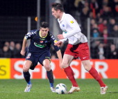 Plabennec's French midfielder Jeremy Pinvidic vies with Reims' French midfielder Johan Ramare during the French Cup football match Plabennec vs Reims...