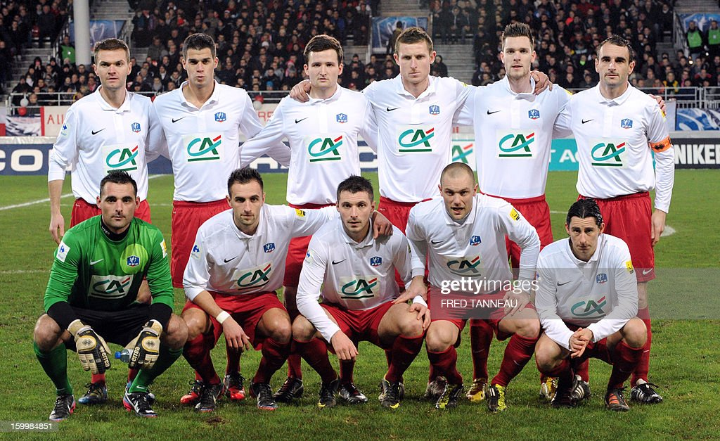 Plabennec's players pose prior to the French Cup football match Plabennec vs Lille on January 24, 2013 in Brest, western of France.