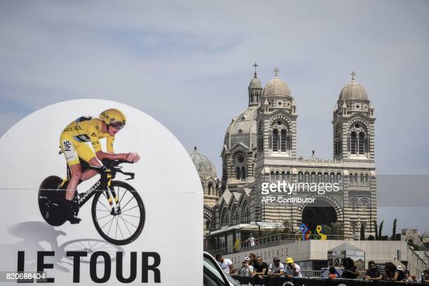 A placard announcing the Tour de France is pictured near the Cathedral of Saint Mary Major prior to a 225 km individual timetrial the twentieth stage...
