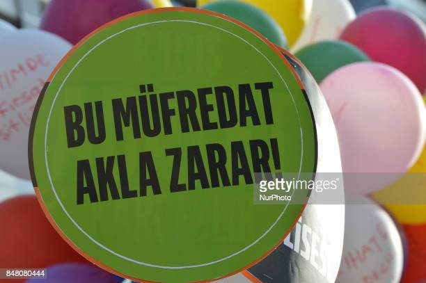 A placard can be seen as people protest against the Turkish government's new education policies in Ankara Turkey on September 16 2017 The Turkish...