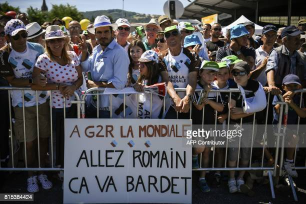 A placard cheering France's Romain Bardet is seen as supporters wait near the start line prior to the 1895 km fifteenth stage of the 104th edition of...