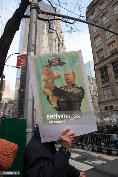 A placard depicting US President Donald Trump as Russian President Vladimir Putin's baby at the Women's March in New York City 21st January 2017