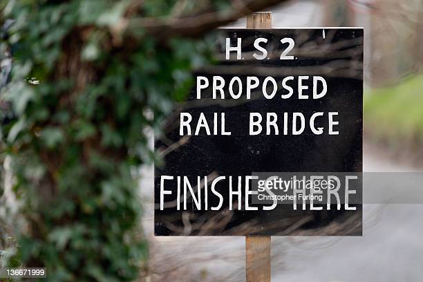 A placard erected by protesters marks the spot where a new rail bridge is proposed to be built across the countryside for the new HS2 high speed...