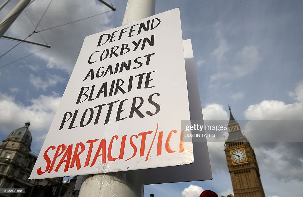 A placard in support of Leader of the opposition Labour Party Jeremy Corbyn is pictured on a flagpole outside parliament during a pro-Corbyn demonstration in central London on June 27, 2016. Britain's historic decision to leave the 28-nation bloc has sent shockwaves through the political and economic fabric of the nation. It has also fuelled fears of a break-up of the United Kingdom with Scotland eyeing a new independence poll, and created turmoil in the opposition Labour party where leader Jeremy Corbyn is battling an all-out revolt. TALLIS
