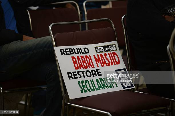 A placard is seen on a chair during a protest by Indian activists to mark the 24th anniversary of the destruction of the Babri Mosque in New Delhi on...