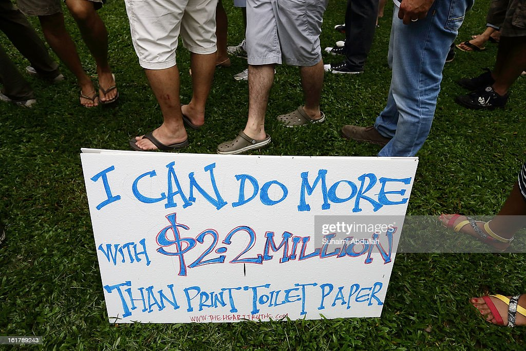 A placard is seen on the ground at Hong Lim Park during the protest against the government's White Paper on Population at Speakers' Corner on February 16, 2013 in Singapore. Thousands of protesters gathered today following the release of a government white paper on population that revealed it could increase 30% to 6.9 million by 2030, angering residents who already see a strain on housing, transportation and healthcare.