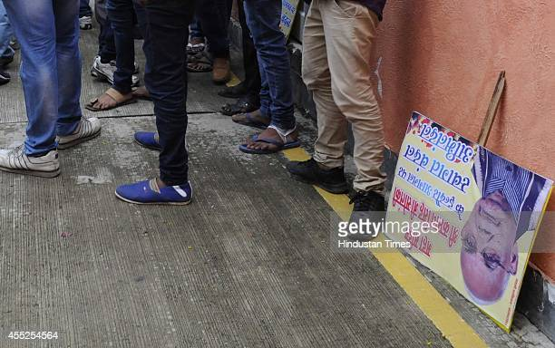 A placard lying on the ground after the welcome ceremony of Haryana governor Kaptan Singh Solanki at Indore airport on September 11 2014 in Indore...