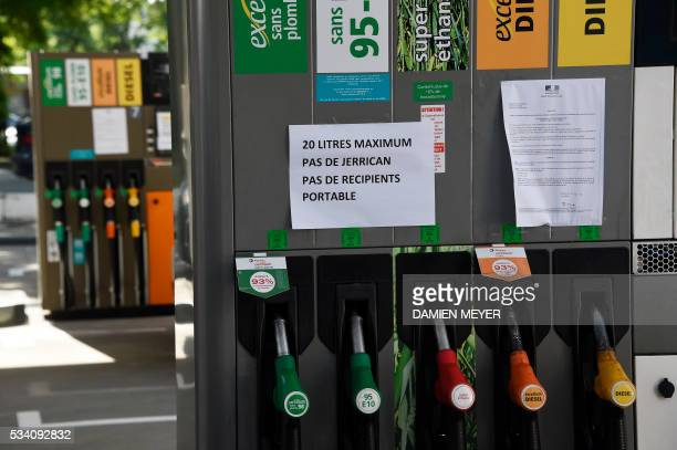 A placard reading '20 liters maximum no jerrican no portative containers' has been set at a gas station in Rennes western France on May 25 as...
