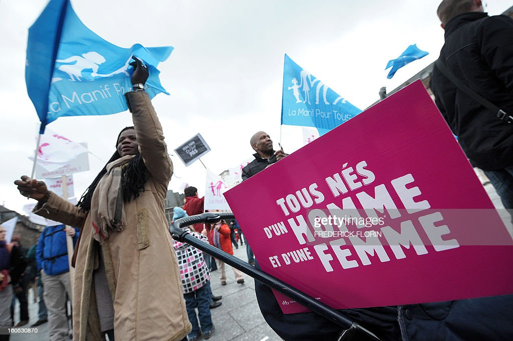 A placard reading 'All born from a father and a mother' is seen on a stroller during a protest against same-sex marriage, on February 02, 2013 in Strasbourg, eastern France, to denounce government plans to legalise same-sex marriage and adoption which have angered many Catholics and Muslims, France's two main faiths, as well as the right-wing opposition. France's National Assembly overwhelmingly approved today the first and most important article of a controversial law that will allow gay couples to marry and adopt children.