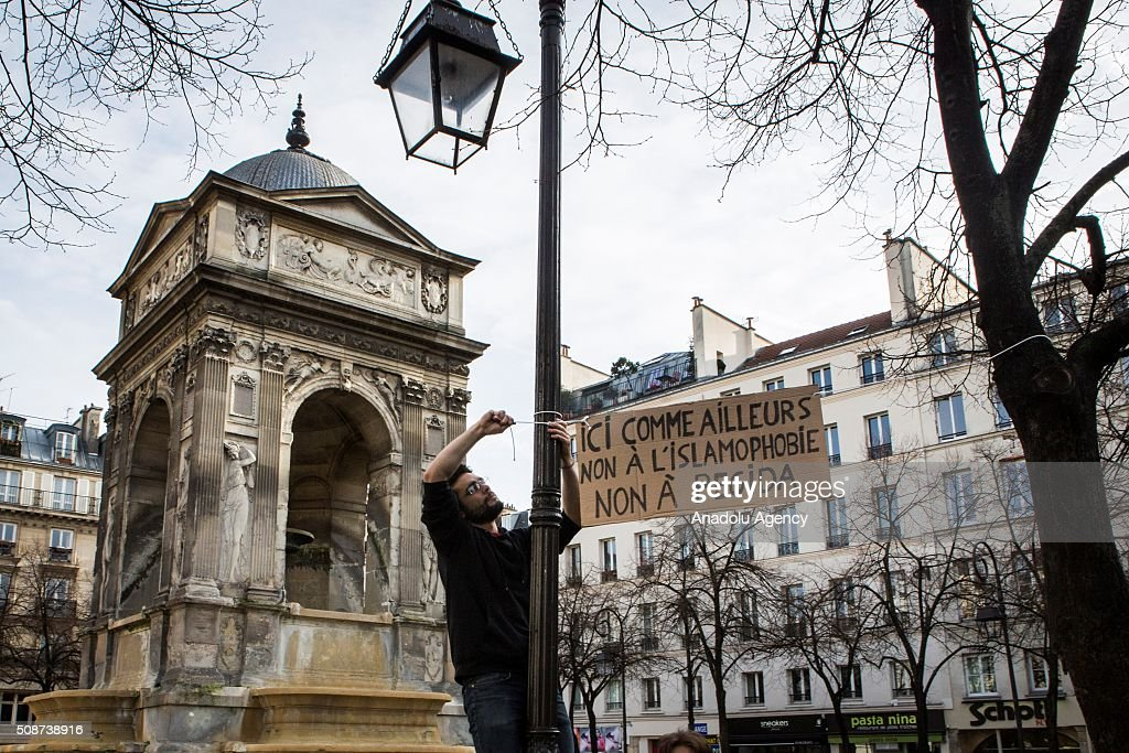 A placard reading in 'Here as elsewhere, No to Pegida, No to Islamophobia' is seen as International human rights groups gathered at Fontaine des Innocents call on France to suspend its state of emergency and end what one has described as 'abusive and discriminatory' measures in Paris, France on February 6, 2016. France introduced a 12-day state of emergency within hours of Daesh-claimed attacks that killed 130 people on Nov. 13. Parliament later extended it for a further three months.