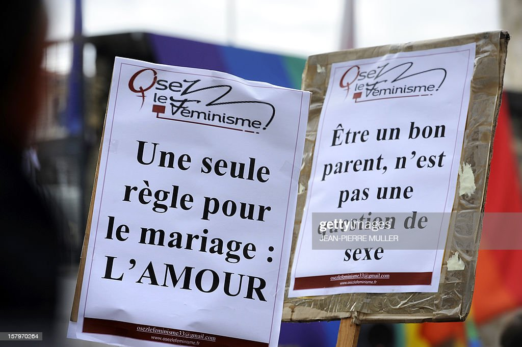 A placard reading 'One single rule for marriage: love' (L) is displayed during a demonstration to support same sex marriages in Bordeaux, south eastern France on December 8, 2012. AFP PHOTO / JEAN PIERRE MULLER