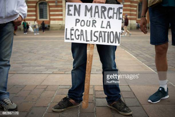A placard reading 'Onwards for legalization' For the Global Marijuana March supporters of legalization for medical and recreationnal use run a stand...