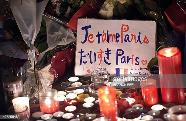 A placard reading 'Paris I love you' is seen among candles at a makeshift memorial in front of the Bataclan theatre one of the site of the attacks in...