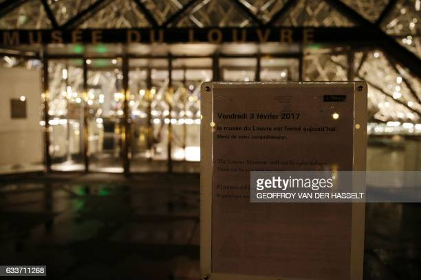 A placard reading 'the Louvre museum will not be open today' is displayed at the entrance of the Louvre museum in Paris on February 3 after a French...