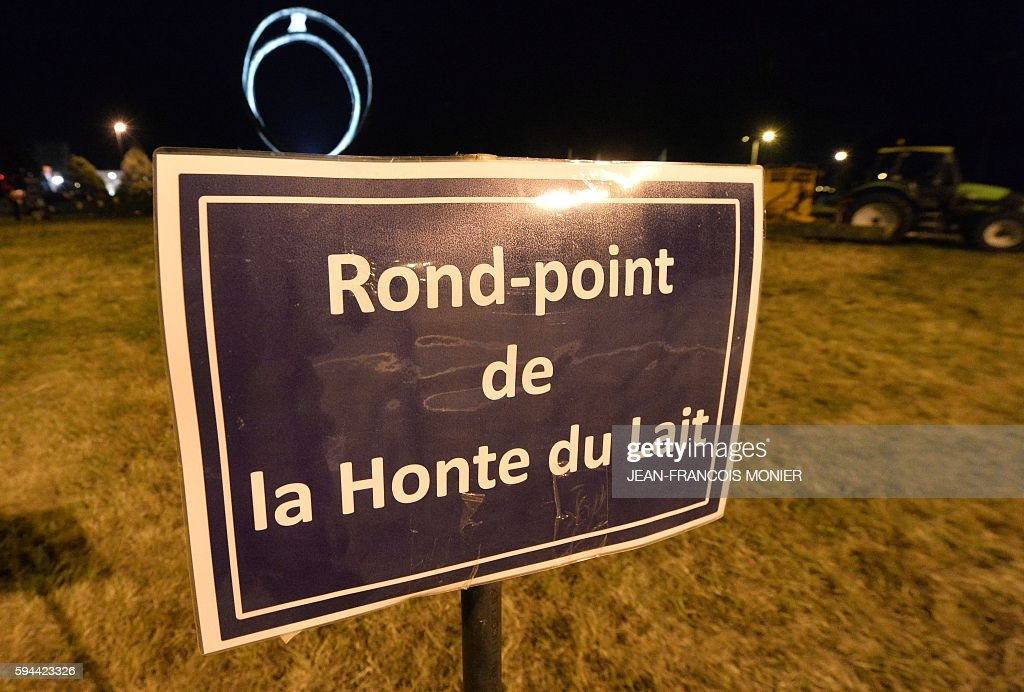 A placard reads 'Roundabout of the shame of milk' outside the Lactalis group headquarters in Change near Laval northwestern France as part of a...