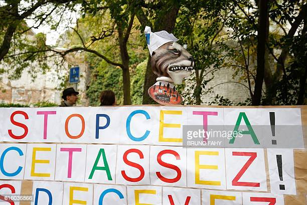 A placard reads 'Stop CETA it's enough' during an antiCETA protest in front the Walloon parliament in Namur Belgium on October 21 during a meeting on...