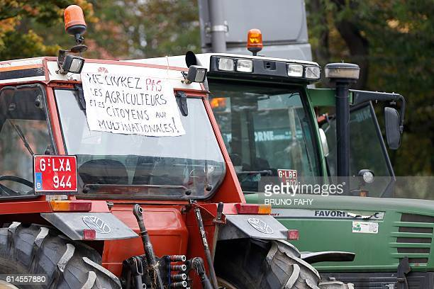 A placard reads 'You won't extradite the farmers and citizens to the multinationals' during a protest of members of FUGEA Federation of Breeders and...
