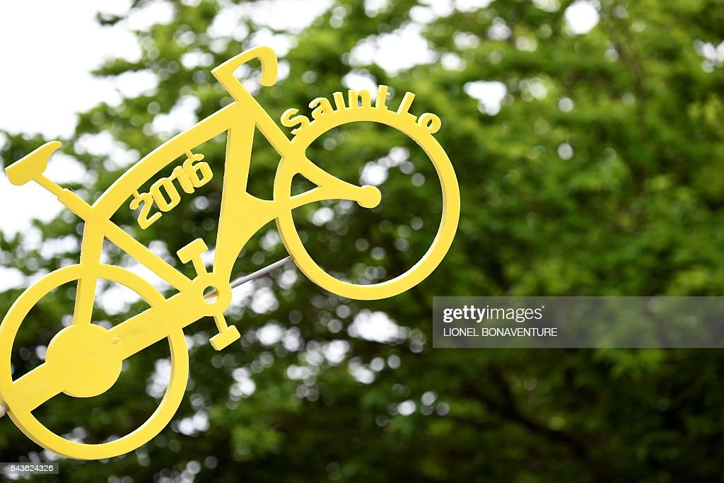 A placard shaped as a bike reads Saint-Lo 2016, is displayed in Saint-Lo, Normandy, on June 29, 2016, three days before the start of the 103rd edition of the Tour de France cycling race. The 2016 Tour de France will start on July 2 in the streets of Le Mont-Saint-Michel and ends on July 24, 2016 down the Champs-Elysees in Paris. / AFP / LIONEL