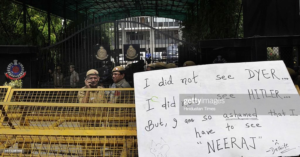 A placard showing hung on barricade during protest outside Delhi Police Headquarters demanding resignation of police commissioner Neeraj Kumar after a brutal rape of 5 year old girl and alleged police insensitivity in dealing with it on April 21, 2013 in New Delhi, India. A five year girl went missing on April 15 and was found on April 17 in same building where she lives with her parents. She was found in serious condition after being brutally raped and tortured with slashed neck and bite marks on her body. The man who lives in that room was arrested in Bihar state on April 20.