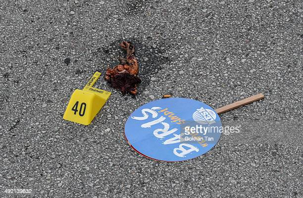 A placard that reads 'Peace Immediately Now' is seen at the site of an explosion in Ankara on October 10 2015 in Ankara Turkey Turkish Health...