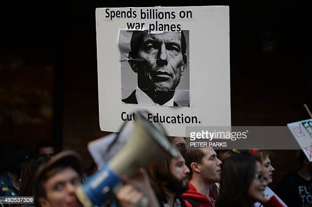 A placard with Australian Prime Minister Tony Abbott on it is displayed at a protest by students at Sydney University on May 21 2014 as thousands of...