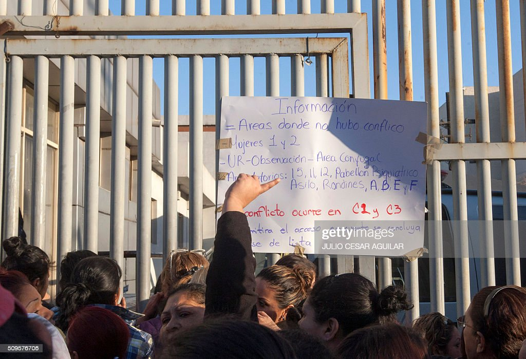 A placard with information with the areas affected by a riot at the Topo Chico prison in the northern city of Monterrey in Mexico is displayed for relatives gathering outside the facility where according to Nuevo Leon State governor at least 52 people died and 12 were injured in a prison riot on February 11, 2016. At least 52 inmates died in a Mexican prison on Thursday as prisoners ignited a fire during a brawl between two rival groups, authorities said. Governor Jaime Rodriguez said the clash erupted at the Topo Chico prison in the northern industrial city of Monterrey before midnight on Wednesday and that authorities brought it under control at 1:30 am on Thursday. AFP PHOTO / JULIO CESAR AGUILAR / AFP / Julio Cesar Aguilar