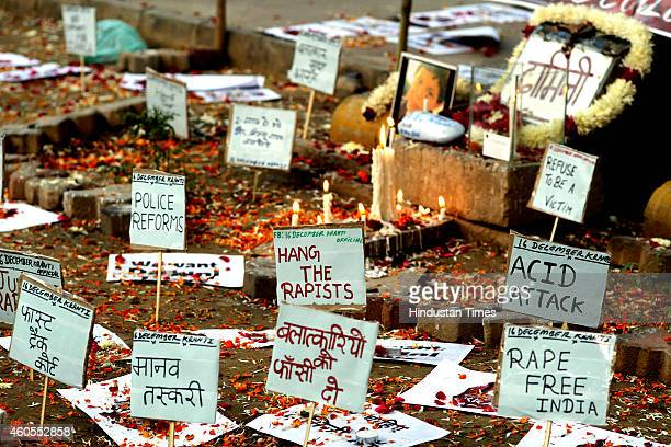 Placards against rape is pictured beside a memorial at the protestors corner in Jantar Mantar on the second anniversary of the fatal gangrape of a...