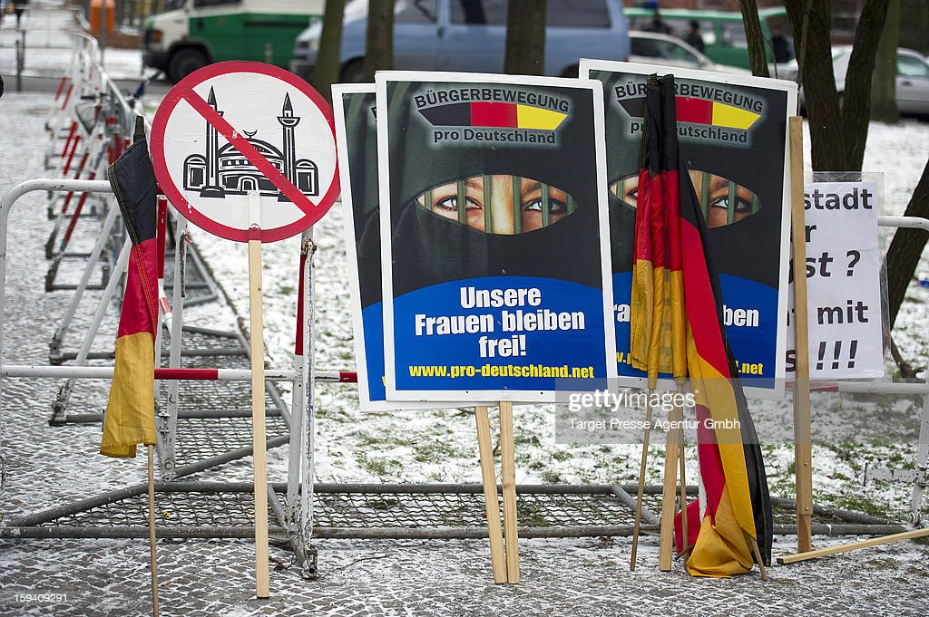 Placards and flags belonging to German radical rightwing-party 'Pro Deutschland'rest against a barrier as Salafites hold benefit rally for Syrian Muslims on January 13, 2013 in Berlin. Two dozen members of 'Pro Deutschland' waited in the centre of Berlin for Salafites who originally planned to hold a public gathering to raise money for Muslims in Syria, which included prominent speakers such as radical Islamic preacher Pierre Vogel. They then moved the event to a private gathering in Neukoelln district. Salafites are an ultra-conservative group of Muslim sunnis with hundreds of members in Berlin and the area around Bonn and cologne. German authorities are keeping a close eye on the group, espacially since clashes that broke out last year in which Salafite demonstrators attacked police and right-wing counter-demonstrators. on January 13, 2013 in Berlin, Germany.