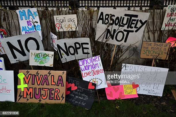 TOPSHOT Placards are left discarded in the garden of the National Gallery at the end of the Women's March in London on January 21 2017 as part of a...