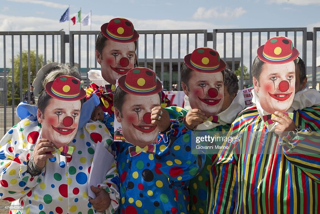 Placards bearing the face of Matteo Renzi as a clown are shown as Labor Unions protest outside the gates of FCA factory during the visit of Italian Prime Minister Matteo Renzi on May 27, 2015 in Melfi, Italy.