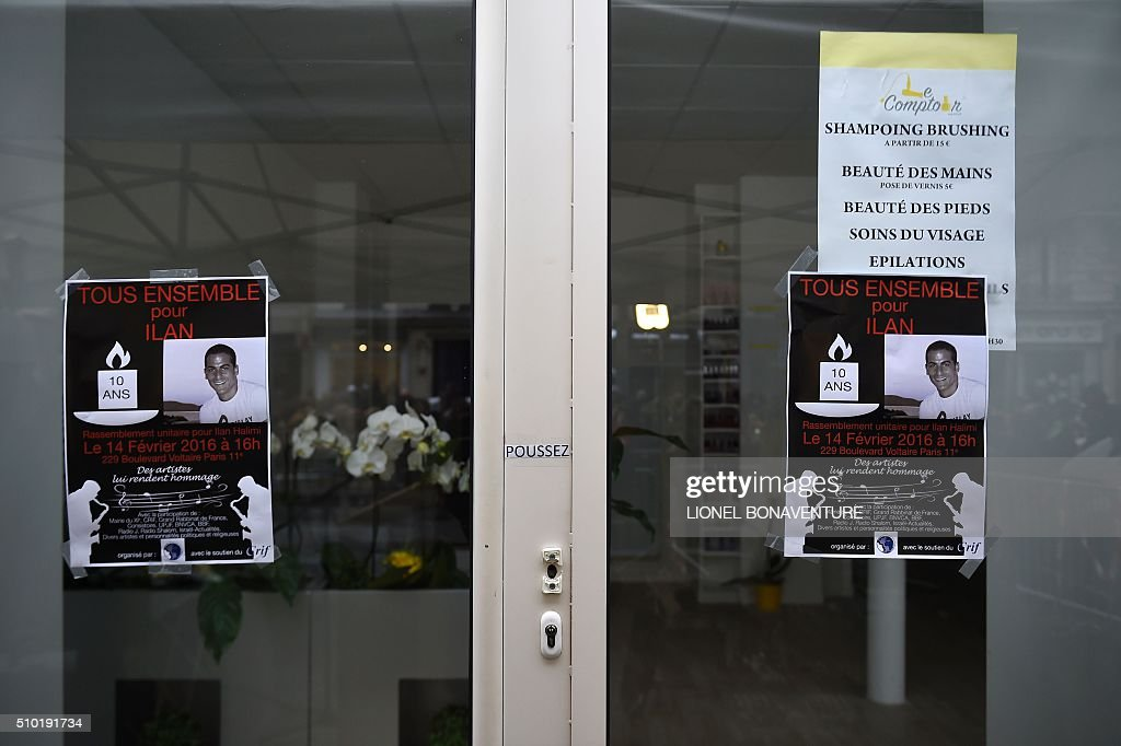 Placards depicting the portrait of Ilan Halimi, are displayed at the entrance of the shop where he was working, during a ceremony in tribute to him on February 14, 2016 in Paris, ten years after the 23-year-old Jewish Frenchman was murdered, on February 13, 2006 after he was kidnapped and tortured for three weeks by a gang in a Paris suburb. AFP PHOTO / LIONEL BONAVENTURE / AFP / LIONEL BONAVENTURE