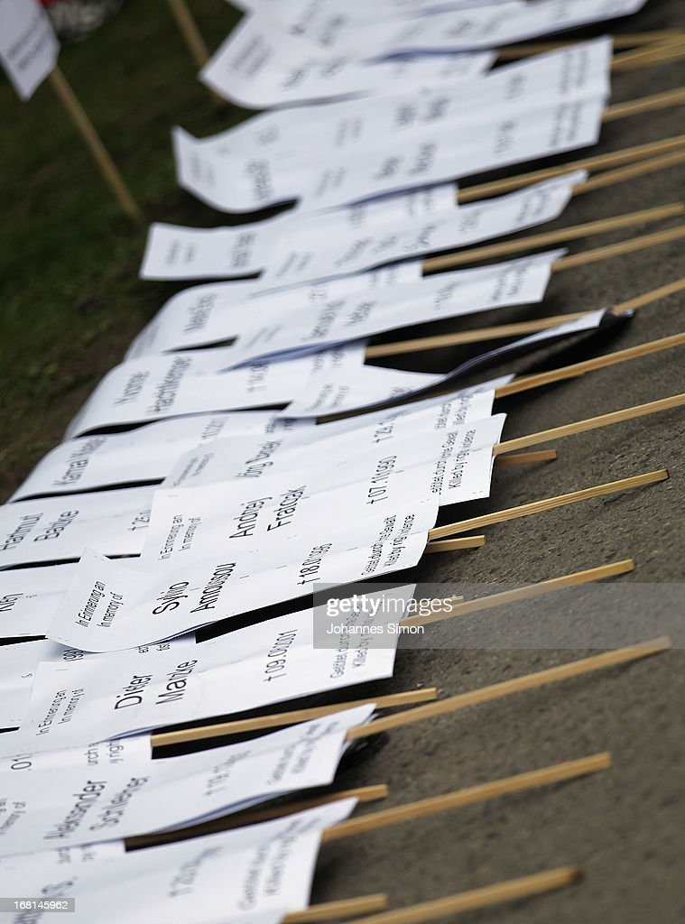 Placards displayed on the road floor memorize the murders committed by the National Socialist Underground, or NSU, outside the Oberlandesgericht Muenchen state court on the first day of the NSU neo-Nazi murder trial on May 6, 2013 in Munich, Germany. The main defendant, Beate Zschaepe, is on trial for her role in assisting Uwe Boehnhardt and Uwe Mundlos in the murder of nine immigrants and one policewoman across Germany between 2000 and 2007, and four other co-defendants, including Ralf Wohlleben, Holder G., Carsten S. and Andre E., are accused of assisting the trio. Zschaepe, Mundlos and Boehnhardt lived together for years undetected by police and called themselves the National Socialist Underground, or NSU. The case only came to light after Mundlos and Boehnhardt committed suicide after the two were cornered by police following a bank robbery in 2011.