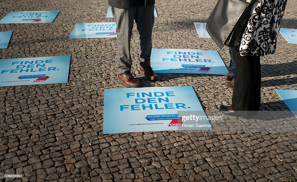 Placards lie on the ground before an action of the German Confederation of Trade Unions (DGB - Deutscher Gewerkschaftsbund) on February 10, 2016 in Berlin. The action picks out as a central theme the conditions of service contracts.