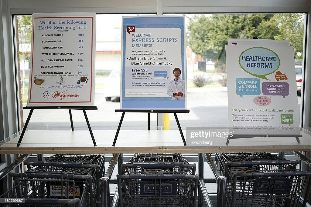 Placards with information about health screenings, health insurance, and healthcare reform are displayed at the entrance of a Walgreen Co. store in Louisville, Kentucky, U.S., on Monday, Sept. 30, 2013. Walgreen Co., the biggest U.S. drugstore chain, is expected to report fourth-quarter earnings before the opening of U.S financial markets on Oct. 1. Photographer: Luke Sharrett/Bloomberg via Getty Images