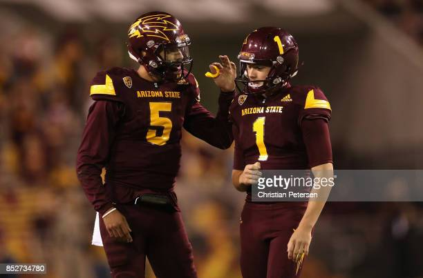 Place kicker Brandon Ruiz of the Arizona State Sun Devils celebrates with quarterback Manny Wilkins after kicking a 41 yard field goal against the...