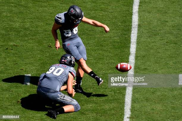 Place kicker Carson Wise of the North Carolina State Wolfpack kicks a field goal against the Syracuse Orange during the football game at Carter...