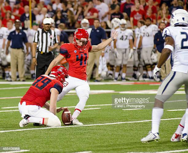 Place kicker Casey Skowron of the Arizona Wildcats kicks an extra point to take a 73 lead against the Nevada Wolf Pack at Arizona Stadium on...