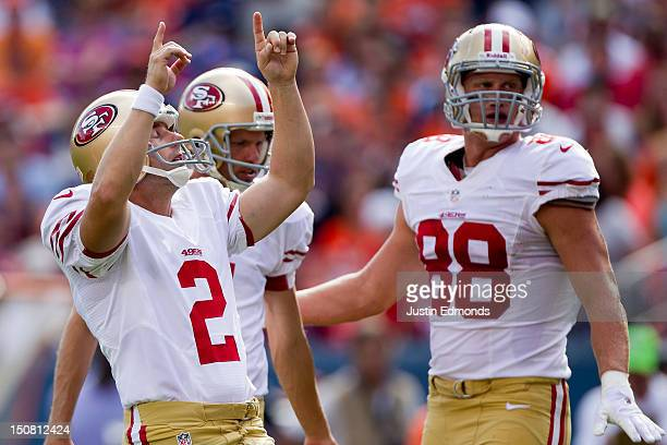 place kicker David Akers of the San Francisco 49ers points to the sky after making a field goal during the fourth quarter of a preseason game against...