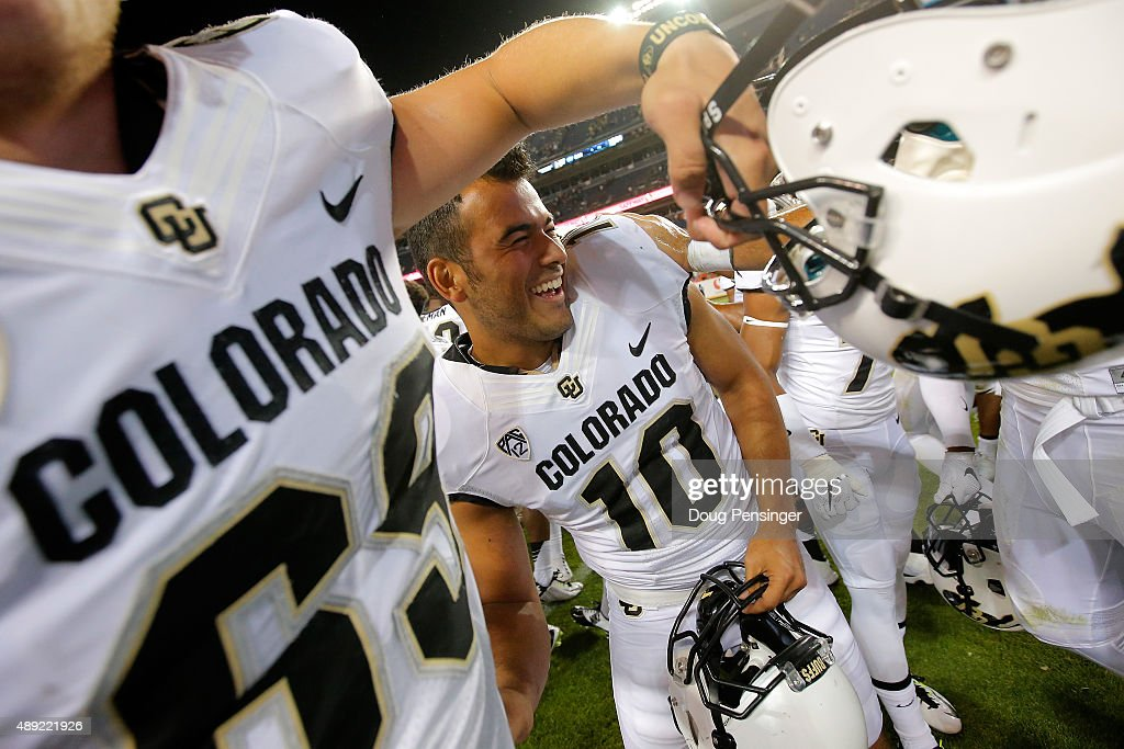Place kicker Diego Gonzalez of the Colorado Buffaloes celebates his game winning 32 yard field goal in overtime to defeat the Colorado State Rams...