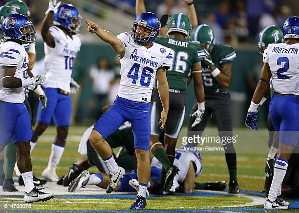 Place kicker Jake Elliott of the Memphis Tigers celebrates after Memphis recovered an onside kick during the first half of a game against the Tulane...
