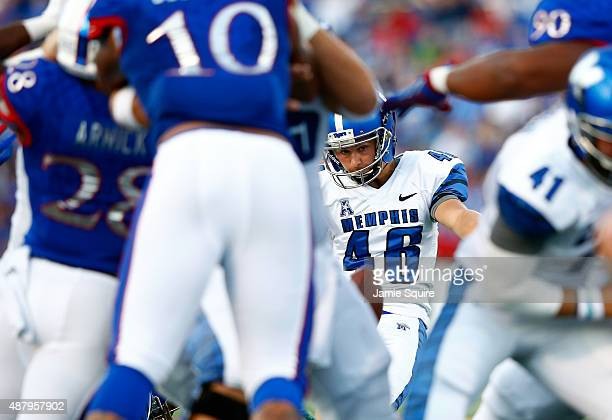 Place kicker Jake Elliott of the Memphis Tigers kicks a field goal during the game against the Kansas Jayhawks at Memorial Stadium on September 12...