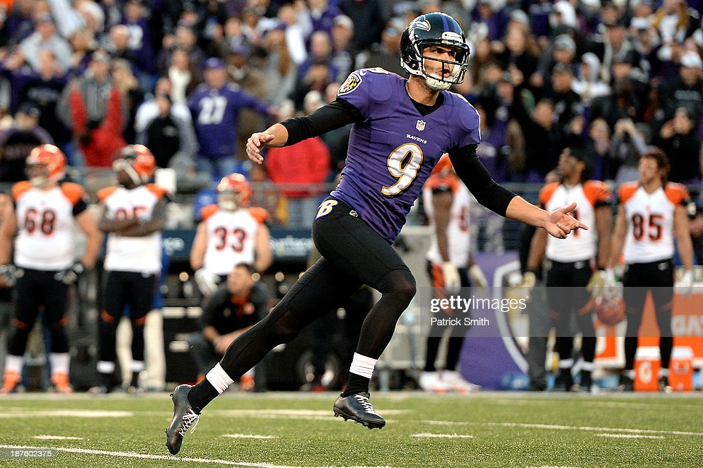 Place kicker Justin Tucker #9 of the Baltimore Ravens celebrates after kicking the game-winning field goal against the Cincinnati Bengals in overtime at M&T Bank Stadium on November 10, 2013 in Baltimore, Maryland. The Baltimore Ravens won, 20-17, in overtime.