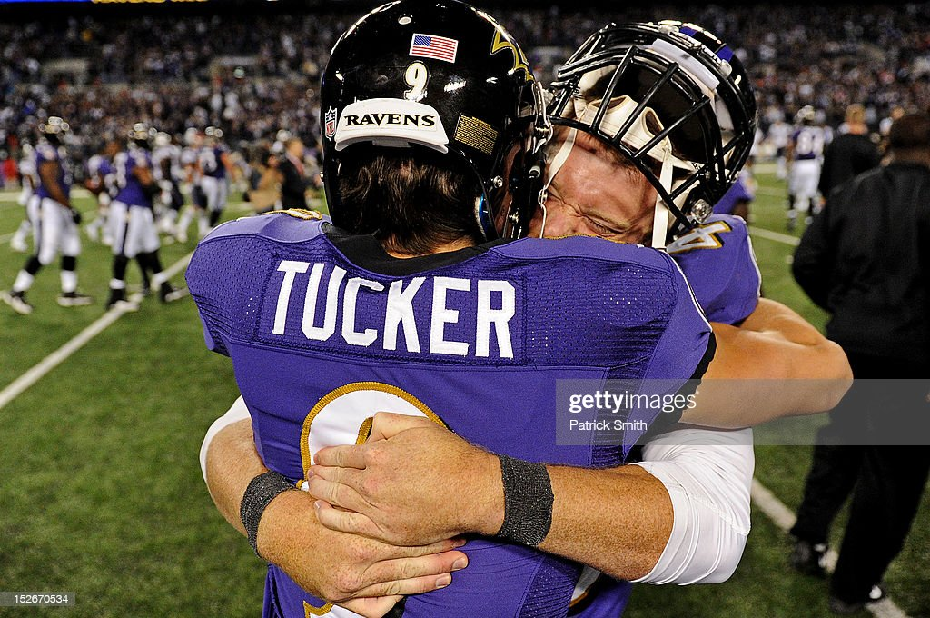Place kicker Justin Tucker #9 of the Baltimore Ravens celebrates with teammate long snapper Morgan Cox #46 of the Baltimore Ravens after kicking the game-winning field goal against the New England Patriots in the fourth quarter at M&T Bank Stadium on September 23, 2012 in Baltimore, Maryland. The Baltimore Ravens won, 31-30