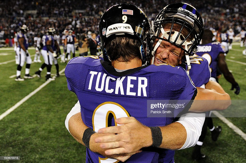 Place kicker Justin Tucker of the Baltimore Ravens celebrates with teammate long snapper Morgan Cox of the Baltimore Ravens after kicking the...