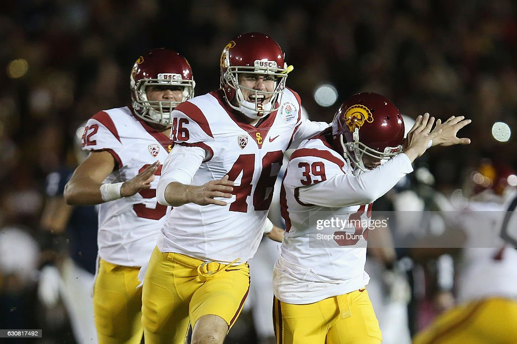 Place kicker Matt Boermeester #39 of the USC Trojans (R) celebrates with teammates after making the game-winning 46-yard field goal in the fourth quarter to defeat the Penn State Nittany Lions 52-49 in the 2017 Rose Bowl Game presented by Northwestern Mutual at the Rose Bowl on January 2, 2017 in Pasadena, California.
