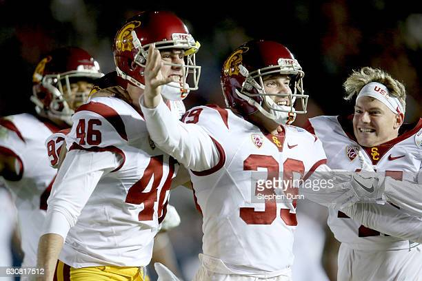 Place kicker Matt Boermeester of the USC Trojans celebrates with teammates after making the gamewinning 46yard field goal in the fourth quarter to...