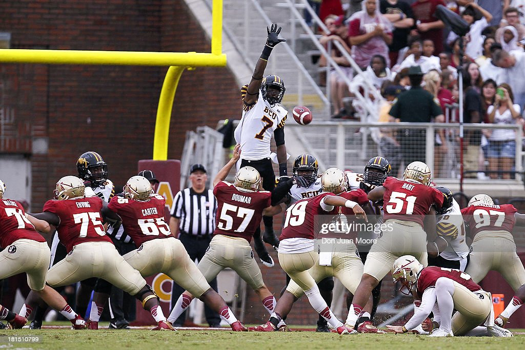 Place Kicker Roberto Aguayo #19 of the Florida State Seminoles kicks an extra point over the hands of Defensive back Nick Addison #7 of the Bethune-Cookman Wildcats at Doak Campbell Stadium on Bobby Bowden Field on September 21, 2013 in Tallahassee, Florida. The 8th ranked Florida State Seminoles defeated the Bethune-Cookman Wildcats 54-6.