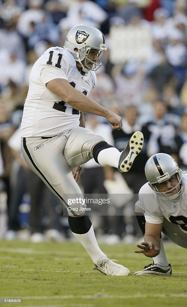 Place kicker Sebastian Janikowski #11 of the Oakland Raiders kicks a field goal during the game against the Carolina Panthers at Bank of America Stadium on November 7, 2004 in Charlotte, North Carolina.
